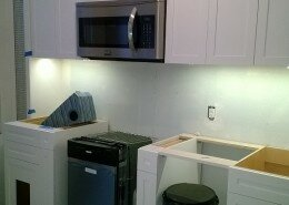 kitchen remodeling in progress - white cabinets